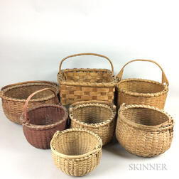 Seven Woven Splint Swing-handled Baskets.     Estimate $100-200