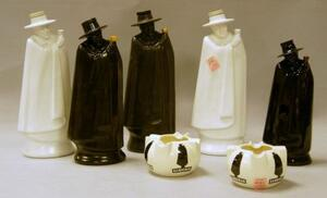 Three Wedgwood, a Royal Doulton, and a Wade Sandeman Figural Decanters and a Pair of Royal Doulton Sandeman Promotional Ashtrays.