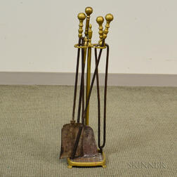 Four Brass Belted Ball-top Fireplace Tools and a Stand