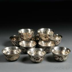 Ten Silver-lined Copper Bowls