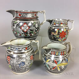 Four Enameled Silver Resist Lustre Ceramic Jugs