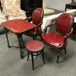 Pair of Leather-upholstered Fauteuil, a Table, and a Stool.     Estimate $300-500