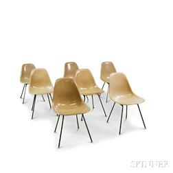 Seven Charles and Ray Eames DCM Chairs