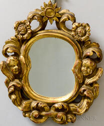 Walfred Thulin (American, 1878-1949)      Carved and Gilded Frame with Flowers and Cherub Heads