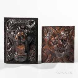 Two Carved Oak Lion Plaques