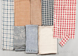 Eight Mostly Checked Linen Textiles