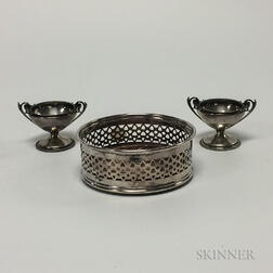 Pair of Silver-plated Salts and a Wood and Silver-plate Coaster.     Estimate $20-40