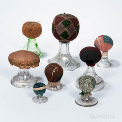 Eight Make-do Pincushions with Glass Bases