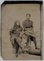 Tintype Depicting Two Black Women Seated on Logs