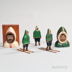 Three Carved and Painted Eskimo Figures