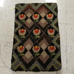 Floral-decorated Hooked Rug.     Estimate $200-250