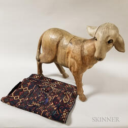 Large Carved Wood Sheep and a Woven Saddle Blanket