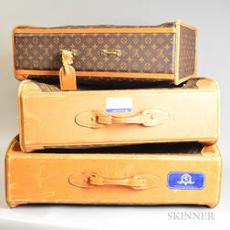 Three Louis Vuitton Leather Soft-sided Suitcases.     Estimate $400-600