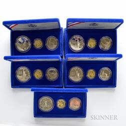 Five 1986 Liberty Gold and Silver Three-coin Proof Sets.     Estimate $1,000-1,200
