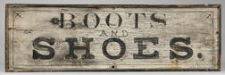 "Painted ""BOOTS AND SHOES."" Sign"