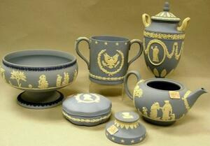 Wedgwood Light Blue Solid Jasper Teapot, Two-Handled Vase, Footed Fruit Bowl, Commemorative Mug, Covered Box, and Paperweight.