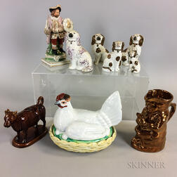Nine Staffordshire Ceramic Figures