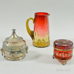Amberina Glass Pitcher, an Enameled Cranberry Glass Dresser Box, and a Silver-plated Victorian Butter Dish with Pressed Glass Insert.