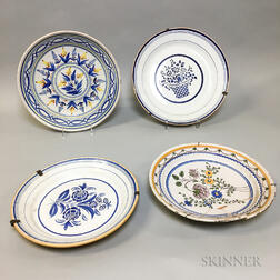 Four Delft and Delft-type Floral-decorated Ceramic Chargers