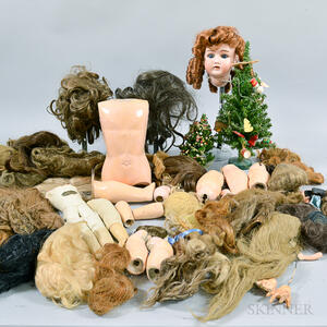 Group of Miscellaneous Doll Parts, Wigs, and Stands.