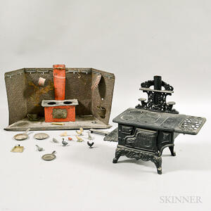 Crescent Cast Iron Toy Stove and a Pressed Tin Toy Stove.
