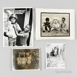 Four Photographs of African American Children.     Estimate $150-250