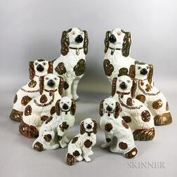 Nine Staffordshire Ceramic Spaniels with Lustre Accents