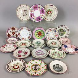 Twenty-eight Pink Lustre Ceramic Plates