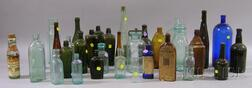 Thirty-five Assorted Mostly Colored Glass Bottles