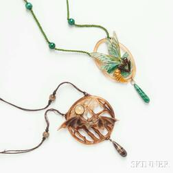 Two French Art Nouveau Stained and Carved Horn Pendants