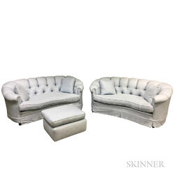 Pair of Blue Tufted Sofas and an Ottoman.     Estimate $400-600