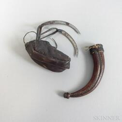 Pair of Metal Cock Fighting Spurs in a Leather Case.     Estimate $150-250