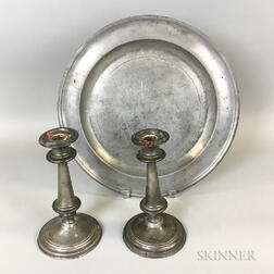English Pewter Charger and a Pair of Weighted Candlesticks
