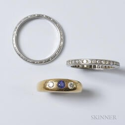 Two Platinum Bands and a 14kt Gold, Diamond, and Sapphire Ring