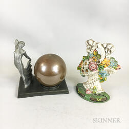 Polychrome Cast Iron Basket of Flowers Doorstop and an Art Deco White Metal Boudoir Lamp.     Estimate $200-300