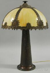 Metal Overlay Caramel Slag Glass Bent Panel Lamp Shade and Patinated Cast Metal   Floral-decorated Lamp Base