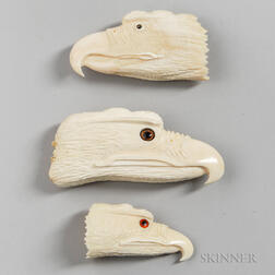 Three Carved Whale Ivory Eagle Heads