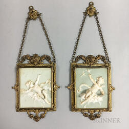Pair of Brass-mounted Relief-molded Ceramic Plaques with Putti
