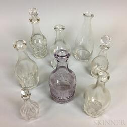 Eight Small Blown Glass Bar Bottles