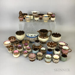 Thirty-seven Pieces of Encrusted Copper Lustre Tableware.