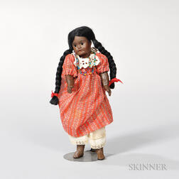 Small Black Bisque Doll.     Estimate $200-300