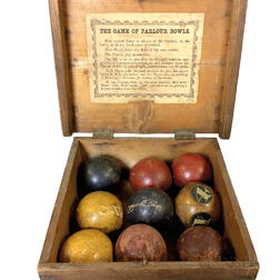 "Boxed and Painted Game of ""Parlour Bowls.""     Estimate $150-250"