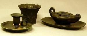 Wedgwood Basalt Oil Lamp-form Inkwell, Enamel Heraldic Decorated Chamberstick, and a Small Pot.