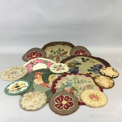 Fourteen Small Round Hooked Mats.     Estimate $150-250