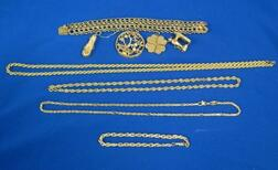 14kt Gold Charm Bracelet with Charms, Three Gold Rope Chains, and a Bracelet.