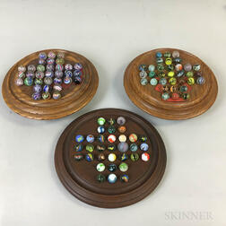 Three Walnut Marble Solitaire Games.     Estimate $150-250