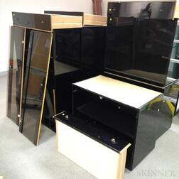 Roche Bobois Parcel-gilt and Black-painted Three-section Cabinet.     Estimate $20-200