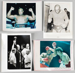 Four Press Photographs of Heavyweight Champion Boxer George Foreman.