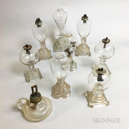 Nine Colorless Glass Oil Lamps