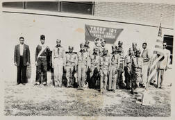 Black and White Photograph of an African American Boy Scout Troop.     Estimate $100-200
